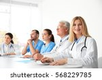 Team Of Doctors Sitting At...