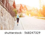 young athletic woman jogging on ... | Shutterstock . vector #568247329