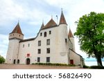 five towered white fairy tale castle Nyon standing on a lake geneva