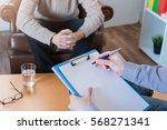 psychologist taking notes... | Shutterstock . vector #568271341