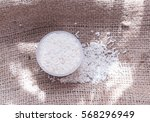 uncooked rice grains on burlap... | Shutterstock . vector #568296949