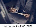 Businessman Hand Write Note Si...