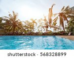 people jumping to the swimming... | Shutterstock . vector #568328899
