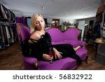 young woman sitting in a boutique - stock photo