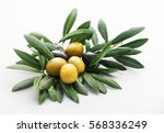 Small photo of green and black olives still life picture on an olives' leaf base