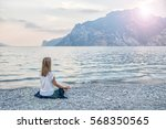serenity and yoga practicing at ... | Shutterstock . vector #568350565