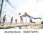 group of friends playing beach... | Shutterstock . vector #568376491