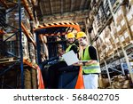 warehouse logistics work being... | Shutterstock . vector #568402705