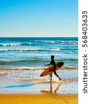 surfer with surfboard walking... | Shutterstock . vector #568403635