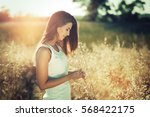 beautiful carefree woman in... | Shutterstock . vector #568422175