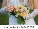 bride holding beautiful wedding ... | Shutterstock . vector #568429651