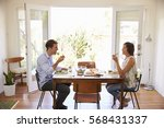 Couple Enjoying Meal At Home...