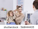 Small photo of ADHD child annoying his mother at psychologist office