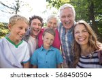 smiling family looking at... | Shutterstock . vector #568450504