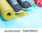 yoga mat  sport shoes  apples ... | Shutterstock . vector #568458691