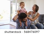 parents playing with baby... | Shutterstock . vector #568476097