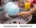 people are making cotton candy... | Shutterstock . vector #568489114