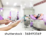 man use mobile phone  blur... | Shutterstock . vector #568493569