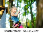 adorable little girl enjoying... | Shutterstock . vector #568517329