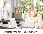 shot of an executive financial... | Shutterstock . vector #568536991