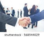 two businessmen making... | Shutterstock . vector #568544029
