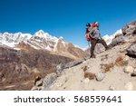 international team of mountain... | Shutterstock . vector #568559641
