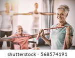 portrait of seniors exercising... | Shutterstock . vector #568574191