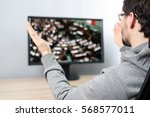 Small photo of agitated man watching (on TV) parliament during vote on laws