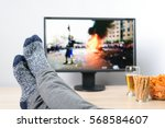 man watching  on tv  news about ... | Shutterstock . vector #568584607