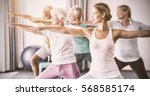 instructor performing yoga with ... | Shutterstock . vector #568585174