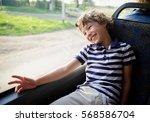 the cheerful little boy in a... | Shutterstock . vector #568586704