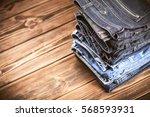 pile of jeans | Shutterstock . vector #568593931