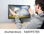 Small photo of agitated man watching (on TV) massive air pollution produced by factories