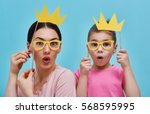 funny family on a background of ... | Shutterstock . vector #568595995