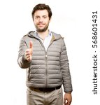 confident man doing a handshake ... | Shutterstock . vector #568601431