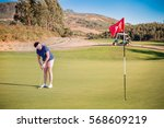 mature woman playing golf with...   Shutterstock . vector #568609219