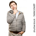 worried young man doubting | Shutterstock . vector #568610689