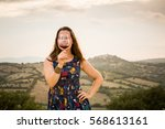 view of a girl in blue dress... | Shutterstock . vector #568613161