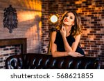 beautiful girl in black dress... | Shutterstock . vector #568621855
