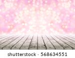 empty wooden table with pink... | Shutterstock . vector #568634551