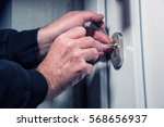 burglar with lock picking tools ... | Shutterstock . vector #568656937