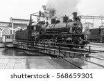 old black steam locomotive in... | Shutterstock . vector #568659301