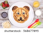 cute pancake in shape of a bear | Shutterstock . vector #568677895
