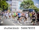 marathon runners in the city  | Shutterstock . vector #568678555
