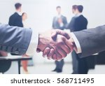 close up of businessmen shaking ... | Shutterstock . vector #568711495