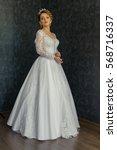 beautiful bride in wedding dress   Shutterstock . vector #568716337