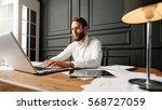 businessman at a workspace... | Shutterstock . vector #568727059