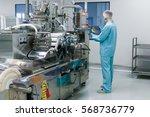 caucasian scientist in blue lab ... | Shutterstock . vector #568736779