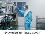 caucasian scientist in blue lab ... | Shutterstock . vector #568736914