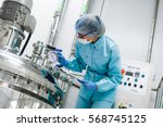 bended scientist in blue lab... | Shutterstock . vector #568745125